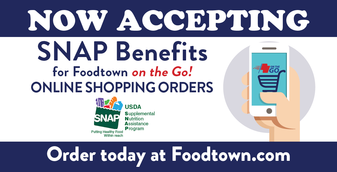 a hand holding up a phone. Text on the image reads now acepting SNAP Benefits for Foodtown on the Go! online shopping orders. Order today at foodtown.com